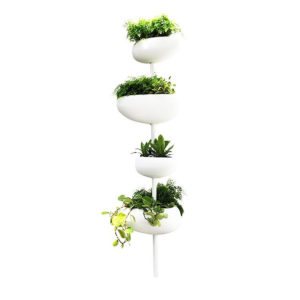 Serralunga's Green Pills planter with green plants
