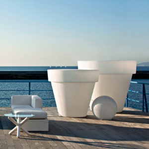 Serralunga's Big Bo planters on the deck on a sunny day against the ocean