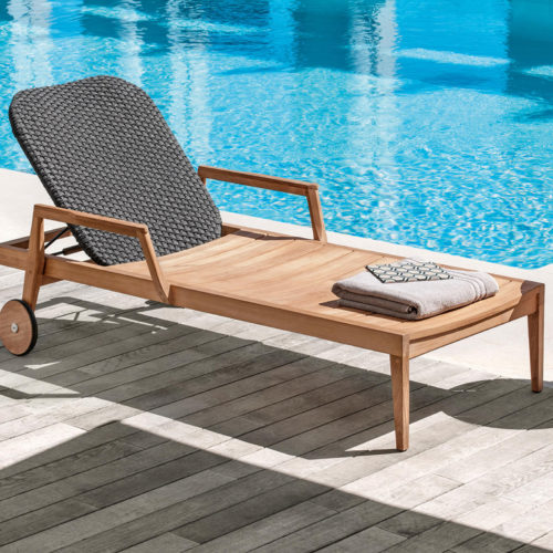 Ethimo's Knit range sun lounger in use by the pool.
