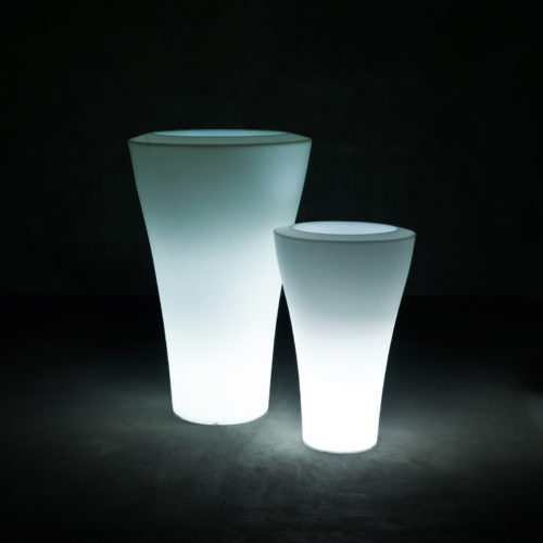 Two of Serralunga's Ming high illuminated planters in a dark setting