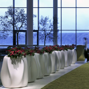 Serralunga's New Wave planters in white with plants in an indoor setting