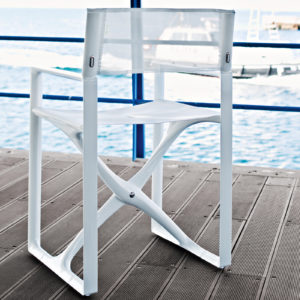Serralunga's Regista white dining chair on a deck overlooking the beach