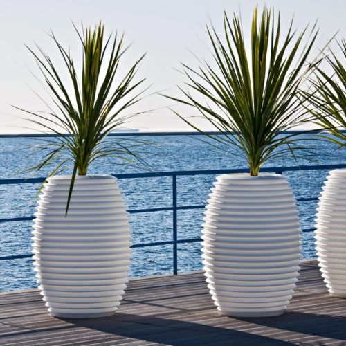 Serralunga's Top Pot Planters in white on a balcony overlooking the ocean