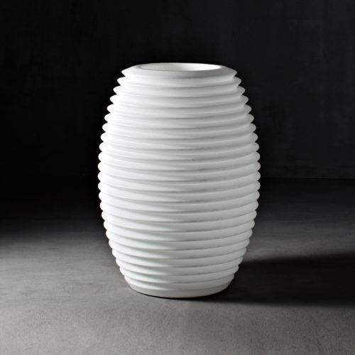 Serralunga's Top Pot Planter in white in a dark setting