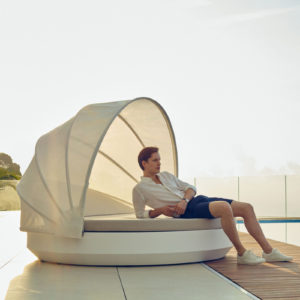 Vondom's basic Vela daybed with a parasol.