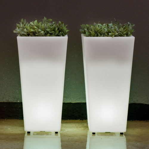 Two of New Garden's light up Melisa planters with plants against a wall