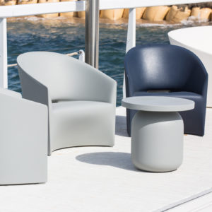 Serralunga's Pine Beach armchairs outside on a deck by the beach