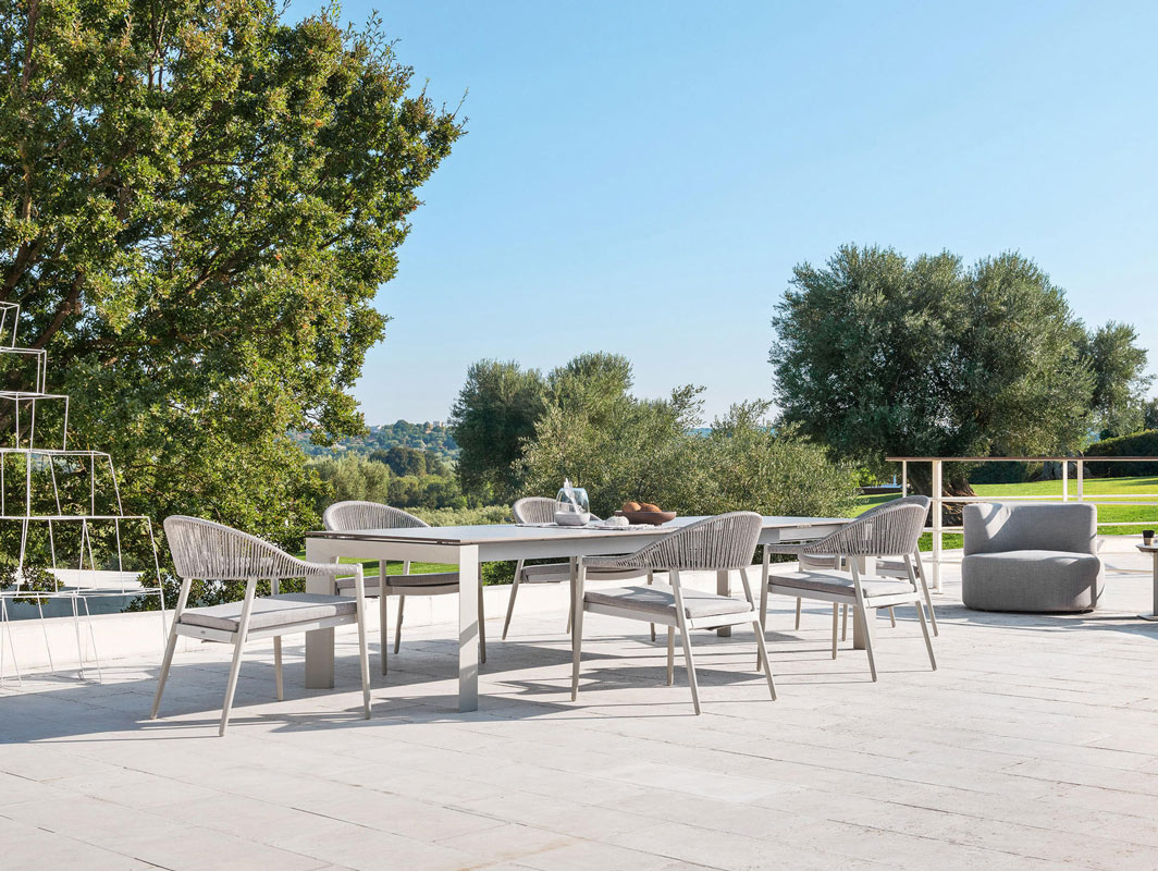 dolmen-low-outdoor-dining-table-varaschin-core-furniture-lifestyle-1