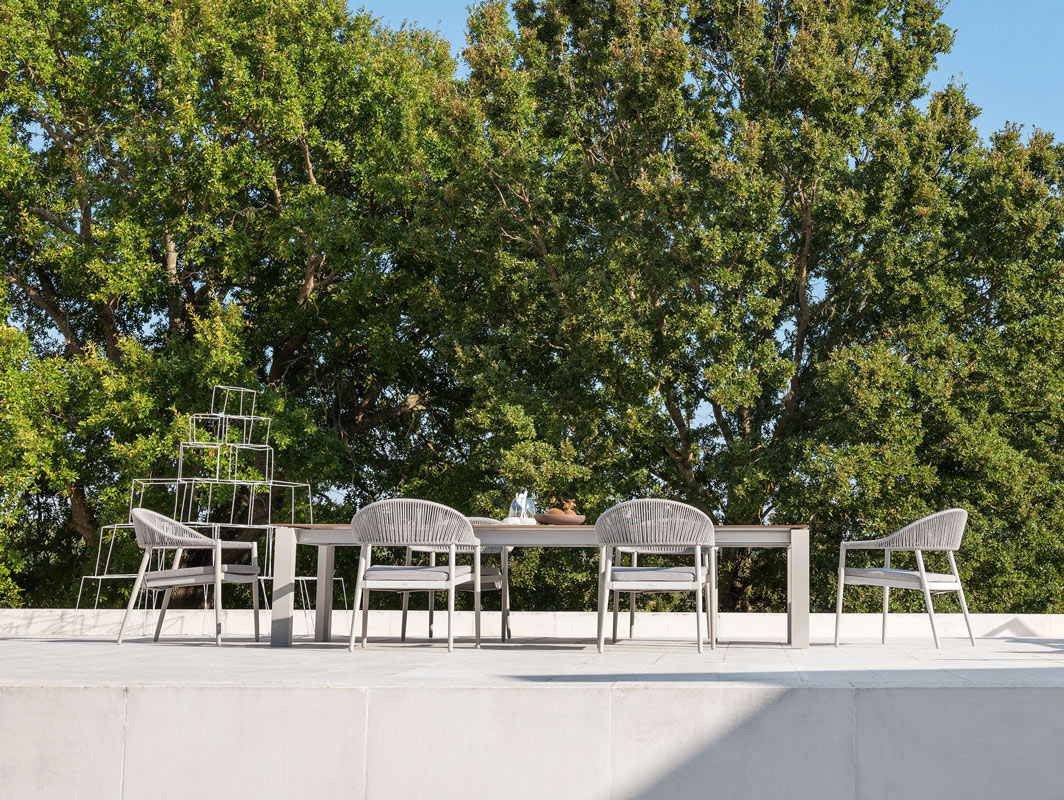 dolmen-low-outdoor-dining-table-varaschin-core-furniture-lifestyle-2
