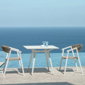 2 Key Dining Armchairs by Talenti by the sea.