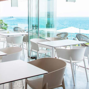 White and pistachio coloured Africa armchairs by Vondom in seaside restaurant.