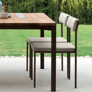 Two Casilda dining chairs in an outdoor setting.