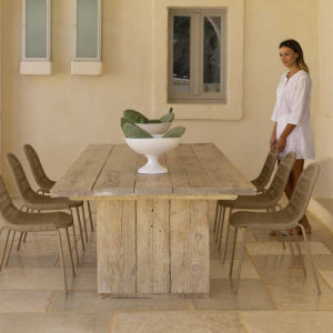6 Panama dining chairs around a wooden dining table.