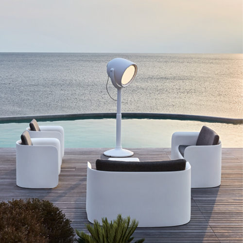 The Hollywood lamp by MYYOUR paired with couches.
