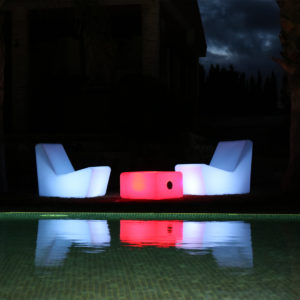 New Garden's illuminated sit chairs and tab in outdoor, night time setting.